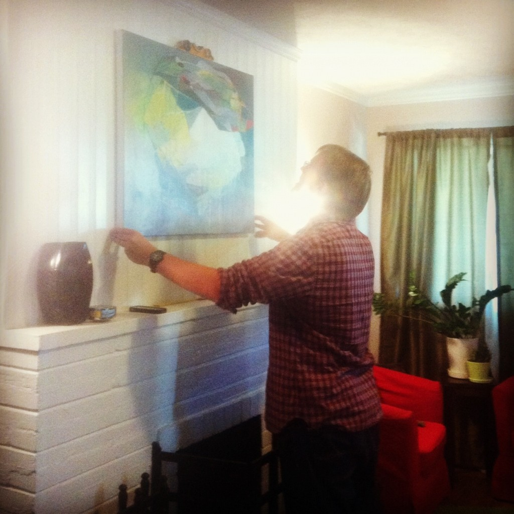 Louie hanging our new painting